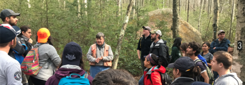 Speaking to group in woods